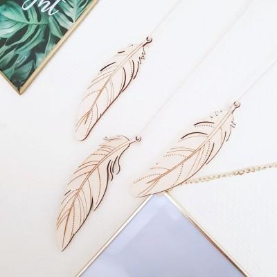 Les 3 grandes plumes décoratives en bois