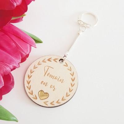 porte-clés en bois témoin en or